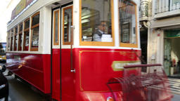 Old tram in Lisbon crossing the street Footage