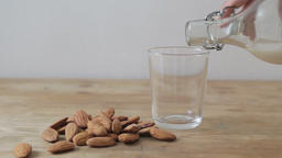 Pouring a glass of almonds milk Footage