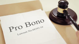 Pro Bono verdict folder with gavel placed on desk of judge in court Footage