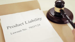 Product Liability lawsuit verdict with gavel placed on desk of judge in court Footage