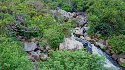 Aerial View Narrow Meandering River with Small Waterfall Footage