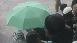 Viewers seat in tribunes in the rain Footage