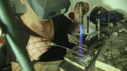 Woman melting and putting a filler metal Footage