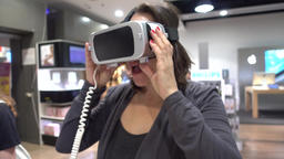 Woman putting on VR headset Footage