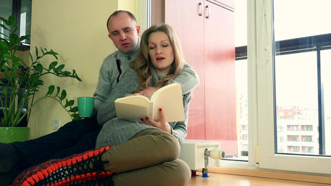 lovely wife and husband spent time together near warm radiator on cold day Footage