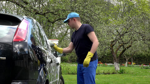 car washing by hand using a foam preparation for polishing Footage