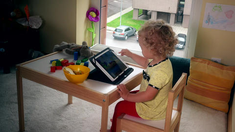 Child playing with tablet. Computer addict girl Footage