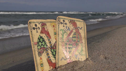 King and queen antique cards on the resort beach Footage
