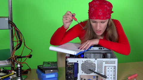 Technician woman examining computer hardware and clipboard in hands Footage