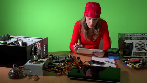 Technician woman looking for information about hardware with tablet computer Live Action