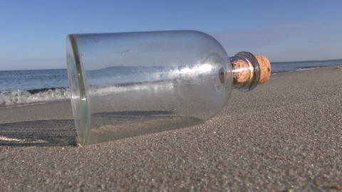 Seascape with bottle in the sand Footage
