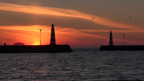 Sunrise at resort harbor and lighthouses Filmmaterial