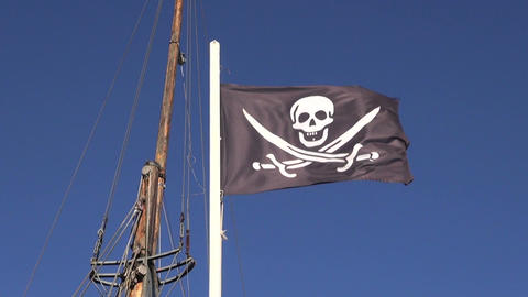 Black pirate flag waving in the wind on the ship Filmmaterial