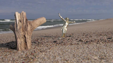 Crucifix and wooden log on the beach Footage