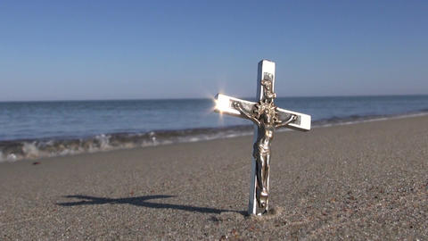 Seascape with religion symbol crucifix in sand Live Action