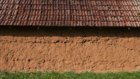 Clay wall of an old farm barn ビデオ