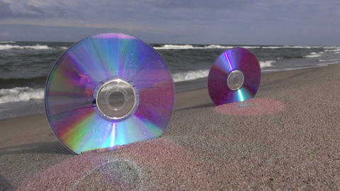 Two CDs by the seascape Footage