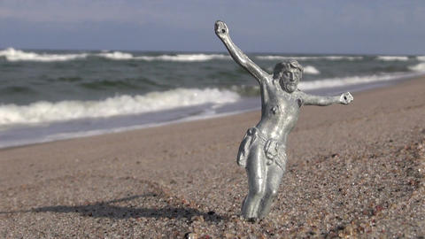 Crucified Jesus Christ without cross on sea beach Footage