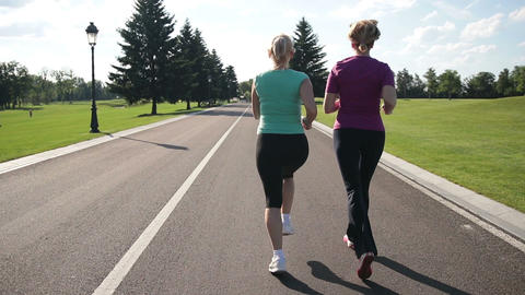 Back view of running women jogging in the park Footage