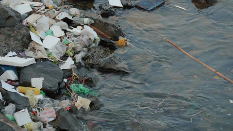 Garbage floating in the water Footage