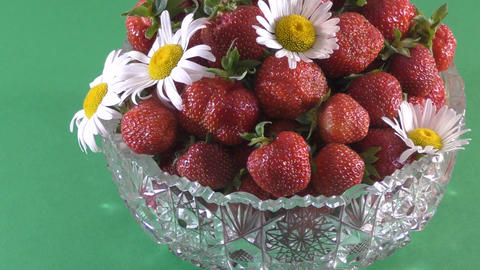 Strawberry and flower daisies