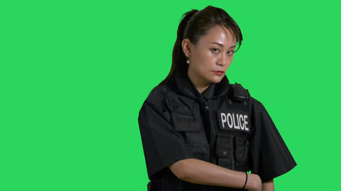 Asian Chinese policewoman pointing pistol on green screen Live影片