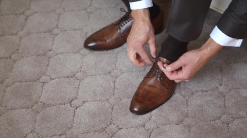 A Man Lacing Up Shoes Footage
