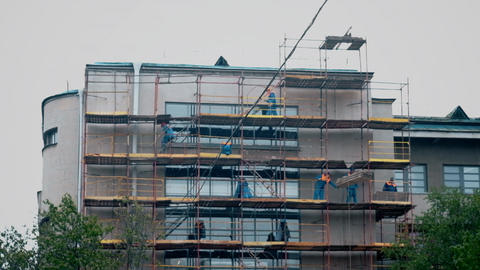 Builders walk on construction scaffolding Footage