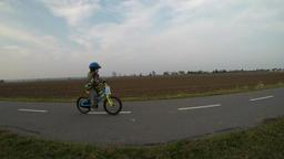Cute little boy riding a bike Footage
