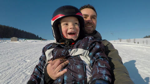 Little boy with his father on a sled Footage