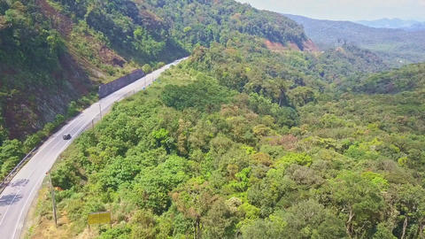 Drone Flies over Modern Mountain Road with Car among Jungle Footage