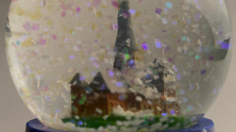 4K Ungraded: Christmas Snow Globe With Colorful Artificial Snowflakes Falling Footage