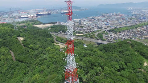 Steel tower for high voltage transmission line rising in the mountain Footage