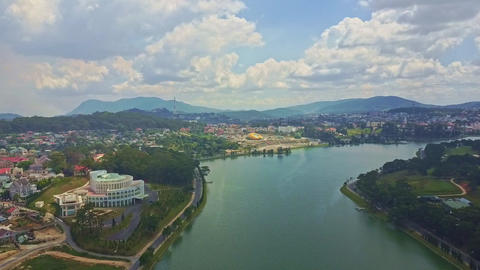 Fantastic Aerial View Quiet Lake with City on Bank Live Action