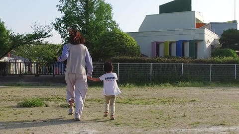 Parent and child walking hand in hand Stock Video Footage