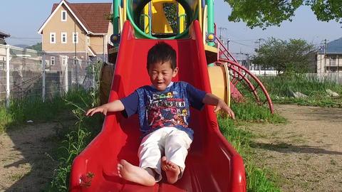 A boy sliding a slide Live Action
