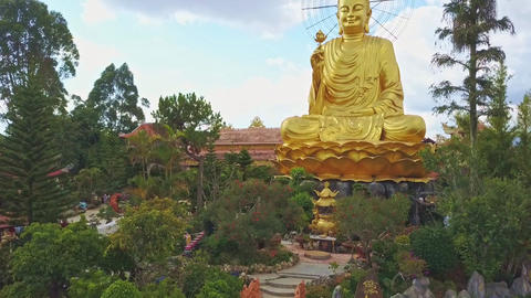 Drone Shows Fantastic Beautiful Gold Buddha with Lotus Flower Footage