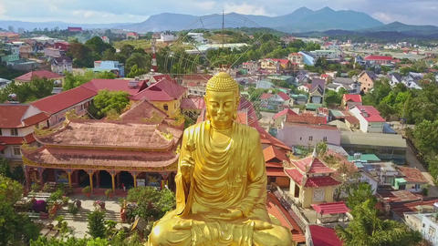 Aerial View Wonderful Large Golden Buddha in Meditation Pose Footage