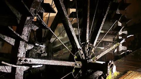 Big steel watemill wheel rotates slowly close up Footage