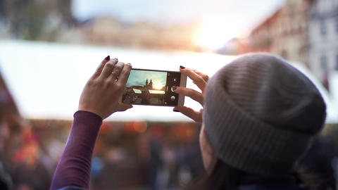 Tourist taking photograph of sunset in Prague skyline view Footage