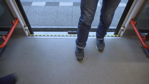 People Walking into the Train at the Station Footage