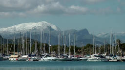 Spain Mallorca Island Port d'Alcudia 002 sailing boats and snow covered mountain Footage