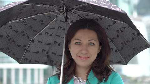 Portrait of stylish woman standing with umbrella Footage