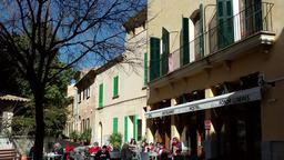 Spain Mallorca Island Alcudia 019 people outside a restaurant on sunny square Footage