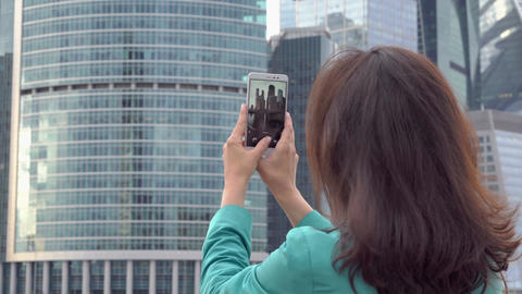 Tourist photographing business center close up Footage
