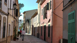 Spain Mallorca Island Alcudia 026 couple with dog in Majorcan old town alley Footage