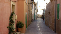 Spain Mallorca Island Alcudia 027 beautiful pastel colored old town alley