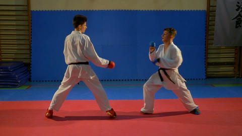 Two boys fighting in a combat and one puts down the other with martial arts tech Footage