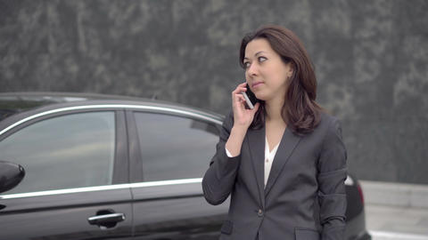 Successful business woman talking on cell phone Footage