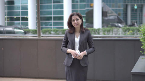 Woman in business clothes approaching to the camera Footage